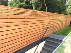Cedar slatted fencing with a combination of large and smaller slats. Back Garden Landscaping, Backyard Fences, Garden Fencing, Contemporary Fencing, Slatted Fence Panels, Modern Fence Design, Garden Screening, Wood Cladding, Horizontal Fence