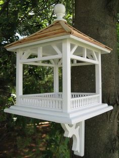 "This fly-through gazebo feeder is perfect for just about any setting. Constructed of exterior grade ply-board, and topped with a pine shingle roof, the large open area can be used with seed or can easily accommodate a piece of fruit for Orioles to enjoy. Item Dimensions: 18"" H x 14"" W x 14"" D All of our pieces are intended for use outdoors. Each is fully functional, with removable back walls for easy cleaning. The hole openings are designed to accommodate common cavity dwellers such as…"