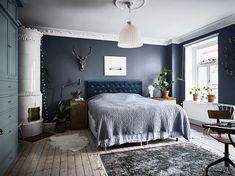 bohemian artist home scandinavian apartment with houseplants wall art fireplace blue walls, bedroom
