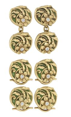 Art Nouveau Gold, Green Plique-à-Jour Enamel and Diamond Dress Set   Including pair of cufflinks and four buttons, the dress set composed of a gold floral motif, applied with a green plique-a-jour enamel background, accented by 8 small old-mine cut diamonds, circa 1900, approximately 22.5 dwts.