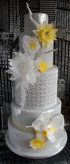 Contemporary wedding cake - love the gray and yellow