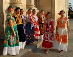 Traditional Mexican Clothing For Women Dress or top, generally a rectangle with embroidered folkloric tales.