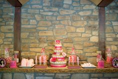 Pink inspired candy bar placed on stone ledge