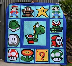 Super Maro Brothers pixelated quilt top  Mario QAL by SuzyBee31, via Flickr