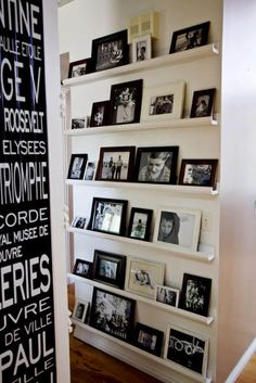 hallway picture walls- black and white framed photos on tray ledges - manditremayne via atticmag