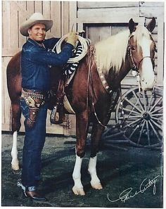 Gene Autry, America's Favorite Singing Cowboy with Champion his horse.  Saw his show everytime he came to town...my childhood hero!