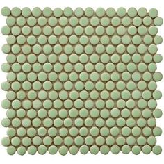Cute green Merola penny round tiles will make a vivid statement in any bathroom!