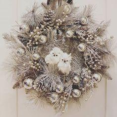Silver snowy owl wreath #happyholidays #owls #wreath #christmaswreath #niagaraflorists