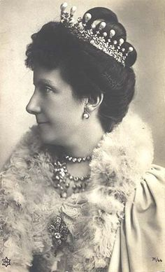 Infanta Maria de la Paz, who's guft the sunburst tiara was, though there doesn't seem to be any images of her wearing it.