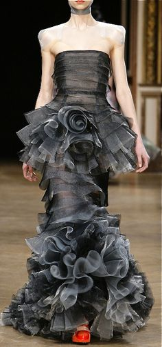 Talbot Runhof..... Fabulous design and would be a fun gown to wear.  B.