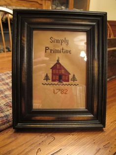 Saltbox sampler...designed and stitched by Yesterday Once More Primitives.
