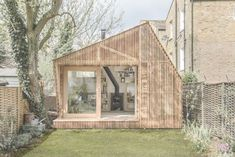Backyard writer's shed with woodburning stove ; Gardenista #site:exteriorism.com