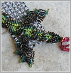 Green Dragon Bracelet - Baby Dragon Fantasy Beaded Cuff. Don't know about the price but man is that gorgeous!