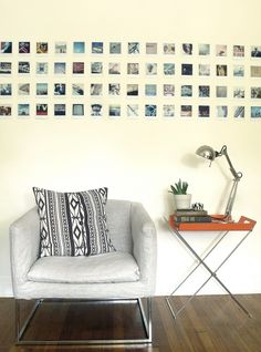 a minimalist display of Polaroid photos. would look great with printed Instagrams! found on Design*Sponge