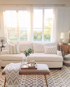 Love this all-white and wood living room style!