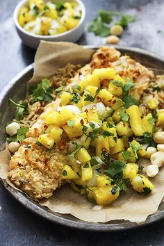 Quick and tasty, tender baked salmon with a macadamia nut crust, topped with sweet and tangy pineapple salsa!