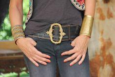 Bronze cuffs & belt. Via Mytenida.