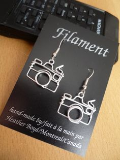 wire camera earrings