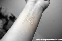 "this white tattoo.  after my mamaw passed, i decided i wanted her hand written ""faith"" written on me somewhere.  she had the strongest faith i ever did see."