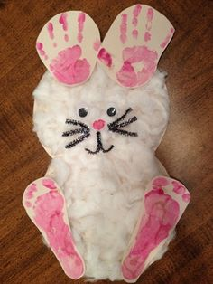 Bunny -- I didn't have a button, so I painted a nose and cut it out. I had silver pipe cleaners for the whiskers, so I used a sharpie to color them, and they look just a little sparkly and more delicate. Pretty good for a non-crafty mom!