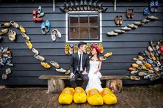 Pre wedding shoot in Holland, Europe. Typical Dutch scenery at the windmill village of Zaanse Schans near Amsterdam. pre wedding photography by Dario Endara Photography