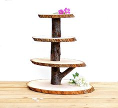 My newest and favorite creation! These wooden cupcake stands are sturdy enough for the handling of guests and when not in use (this is the best), they are easily disassembled to store without taking up too much space. Beautiful as well as functional. Coated with an eco-friendly sealant to protect the wood and ensure a long life. You choose the size desired upon purchase.  -Three (3) tier stand holds approximately 40 cupcakes -Four (4) tier stand holds approximately 50 cupcakes -Five (5) tier…