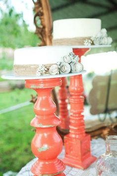 Candle sticks turned into cake stand. Paint, distress and add a plate. Decorate with twine, book page flowers, and baby's breath. Simple, easy and so pretty.