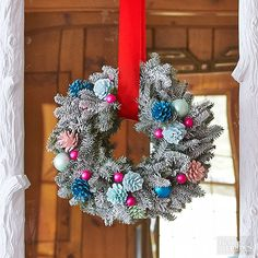 Give your wreath a retro vibe with a few brightly colored elements. Purchase a fir wreath and spray-paint it evenly with white paint. Add bright colored accents -- a few pinecones spray-painted in a bright hue, miniature holiday ornaments -- and hang with a ribbon./