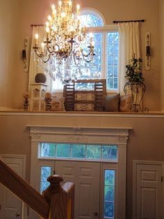 foyer ledge, plant ledge decorating, two story foyer with shelf above door with window. Above Door Decor, Window Ledge Decor, Front Door Decor, Entryway Decor, Wall Ledge, Front Doors, Wall Niches, Entry Foyer, Bedroom Decor