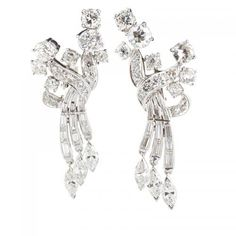 Set with cluster of RBC and OEC diamonds to baguette-cut diamond ribbons suspending marquise-cut diamond fringe, approx. 4.25 cts. TW throughout, mounted in pla