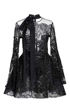 This **Elie Saab** bead embroidered dress features a round neckline with a bow tie design, full length sleeves, and an A-line short skirt.