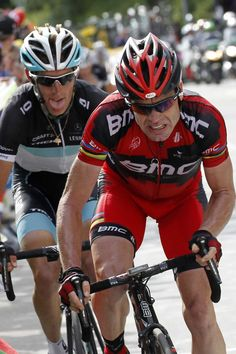 Andy Schleck and Cadel Evans climb Alpe d'Huez on the 19th stage of ...