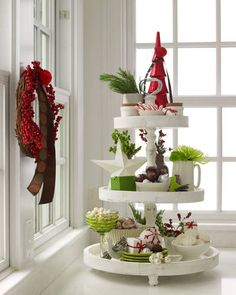 Even just one strong piece can add major drama. Here, candies, dazzling greens, and keepsakes are irresistible layered on an old-fashioned tiered cake stand. Mix and match shapes and sizes, sticking with a few colors for a clean look.    - ELLEDecor.com