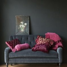 Charcoal grey and purples make for an unexpected twist on traditional decor. It is wonderful.