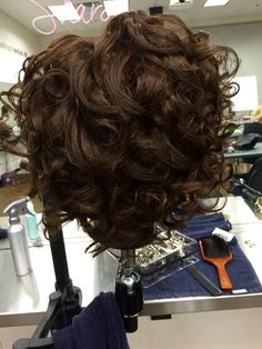 Marcel curls, back view. In class assessment