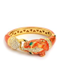 This gorgeous bangle works a delightfully exotic and royal vibe, with its sleek tiger silhouette and glittering array of gems. Plus, that gold tangerine palette, in glossy enamel, packs a stylish punch.