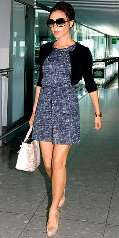 Victoria Beckham in black cardigan, Goat minidress, Hermes bag, and Brian Atwood pumps