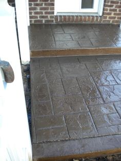 Does this stamped concrete hold up better than tile or wood in an outdoor living space?