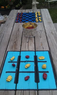 We have a small yard so utilizing space and making the most of what we have is the goal. Painted checker board and tic tac toe on picnic table. Painted rocks like lady bugs and bumblebees for pieces. Now 2 more games for kids to play outside. Painted Picnic Tables, Kids Picnic Table, Picnic Table Paint, Painted Game Table, Painted Table Tops, Picnic Area, Backyard Games, Outdoor Games, Outdoor Camping