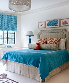 Soften bold colors with tricks that add texture and depth, like layering rugs and tossing on the accent pillows.