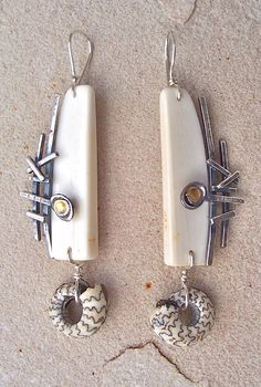 Fossilized Walrus ivory, ammonites, sterling silver, 24kt gold.  Lesley Aine McKeown