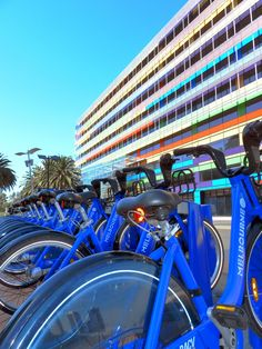 Melbourne public bike hire and colourful building as a background crazyMelbourne.com @TheCrazyCities