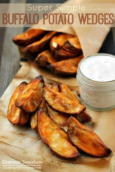Super Simple Buffalo Potato Wedges - perfect potato/spicy ratio and serve with ranch or bleu cheese YUM!