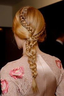 Temperley London Elegant: Romantic and bohemian, the long side plaits by Malcolm Edwards at Temperley London had smaller braids woven into them for an intricacy that mirrored the detailing of the clothes. Photo By James Cochrane