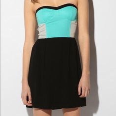 Sparkle & fade colorblock strapless dress Has a zipper and clasp in the back, gently worn, very cute. Urban Outfitters Dresses