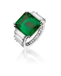 Alexandre Reza - 7.89cts Colombian emerald, no oil, set with 26 diamonds for 3.8cts. Set on platinum.