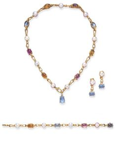 A SUITE OF GEM-SET AND CULTURED PEARL JEWELRY, BY BULGARI Designed as a series of cultured pearl, measuring from approximately 8.70 to 9.40 mm, and polished gold fancy links, accented by circular-cut diamonds, spaced by alternating cabochon pink tourmaline, blue topaz and citrine links; a pair of ear pendants and a bracelet en suite, mounted in 18k gold, necklace 17¼ ins., bracelet 7¼ ins. Signed Bulgari