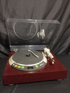 DENON MODEL DP-62L AUTOMATIC ARM LIFT DIRECT DRIVE TURNTABLE SYSTEM.