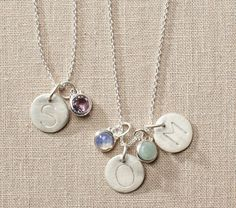 Initial necklace with birthstone. They say it's for kids, but I think it's good for moms, too.