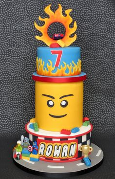 Lego Hot Wheels Birthday Cake with Lego Head and Flames, pambakescakes pam bakes cakes Bolo Hot Wheels, Hot Wheels Cake, Festa Hot Wheels, Hot Wheels Party, 6th Birthday Parties, Birthday Cake, Birthday Celebrations, Themed Parties, Birthday Ideas